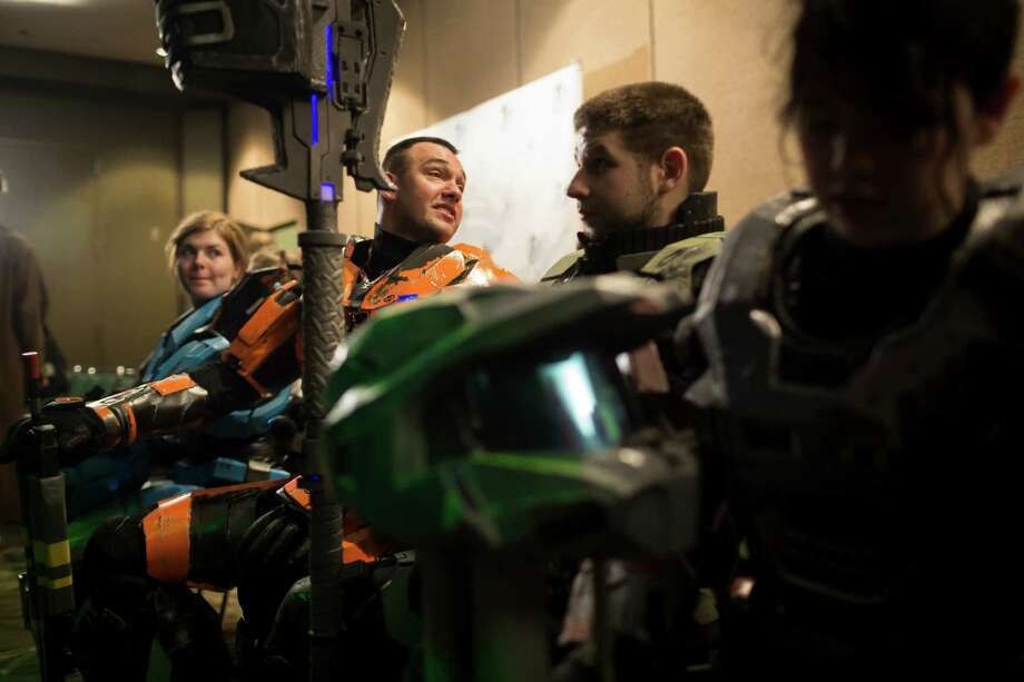 Spartan soldiers from the Halo video game await their performance in the costume competition on the second day of the annual Emerald City Comicon on Saturday, March 2, 2013, in the Washington State Convention Center in Seattle, Wash. Photo: JORDAN STEAD / SEATTLEPI.COM
