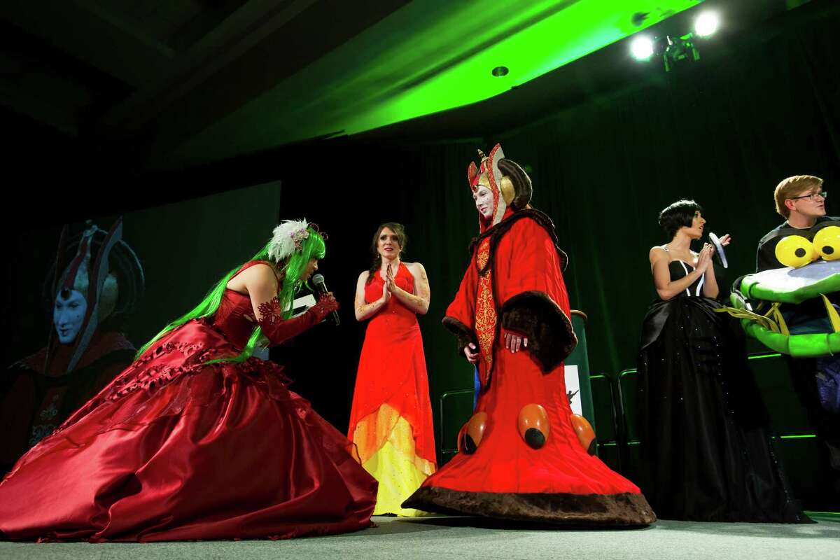 Judges recognize Crystal Von Oy, center right, dressed as Queen Amidala of Star Wars fame, on her second place in the costume competition on the second day of the annual Emerald City Comicon on Saturday, March 2, 2013, in the Washington State Convention Center in Seattle, Wash.