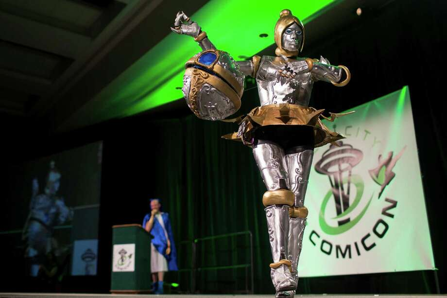 Attendees strut their costumed stuff for a panel of judges during the costume competition on the second day of the annual Emerald City Comicon on Saturday, March 2, 2013, in the Washington State Convention Center in Seattle, Wash. Photo: JORDAN STEAD / SEATTLEPI.COM