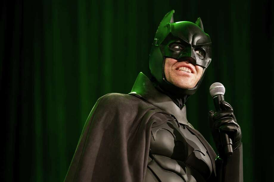 Brandon Nicholas, dressed as Batman, answers questions about his suit to a crowd of onlookers during the second day of the annual Emerald City Comicon on Saturday, March 2, 2013, in the Washington State Convention Center in Seattle, Wash. Photo: JORDAN STEAD / SEATTLEPI.COM