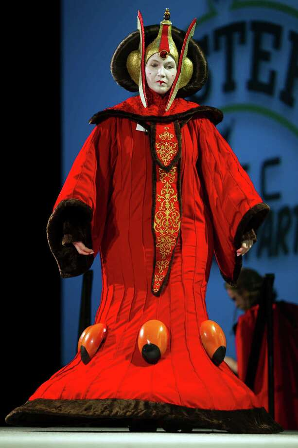 Crystal Von Oy, dressed as Queen Amidala of Star Wars fame, takes to the stage of the costume competition on the second day of the annual Emerald City Comicon on Saturday, March 2, 2013, in the Washington State Convention Center in Seattle, Wash. Photo: JORDAN STEAD / SEATTLEPI.COM