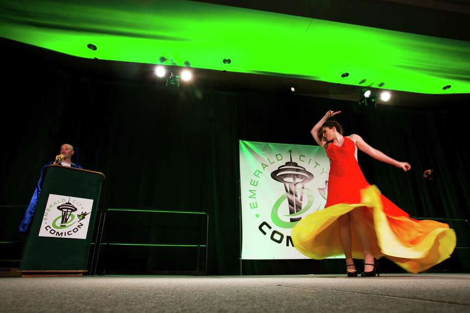 Jina, right, dressed as Katniss from Hunger Games, dances for a panel of judges during the costume competition on the second day of the annual Emerald City Comicon on Saturday, March 2, 2013, in the Washington State Convention Center in Seattle, Wash. Photo: JORDAN STEAD / SEATTLEPI.COM