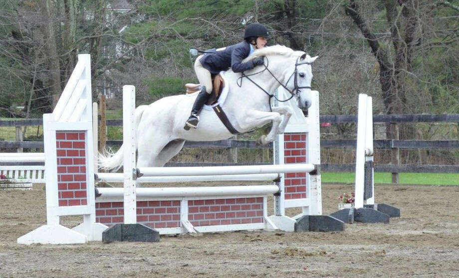 """Riding Cody, Emma Sapio, a Darien sophomore who attends Convent of the Sacred Heart, has been a member of the New Canaan Mounted Troop since 2004, and believes that it has taught her """"how to ride, but also how to be a leader and to take responsibility."""" Photo: Contributed"""