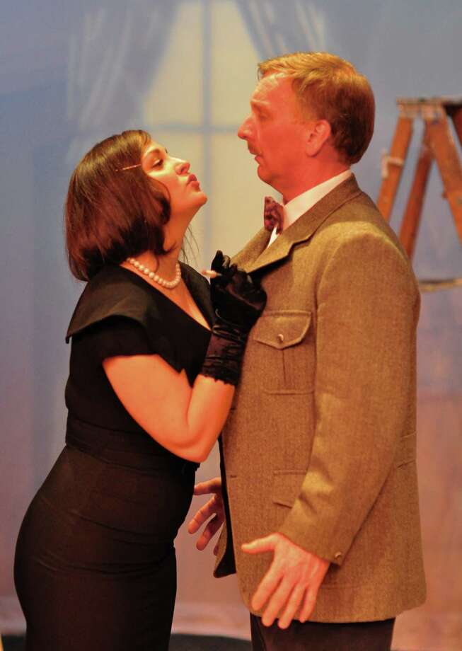 """Rehearsing a scene from """"The 39 Steps"""" at the Darien Arts Center Stage are Melissa Schleier as Annabele Schmidt and David Victor as Richard Hannay. Photo: Contributed"""