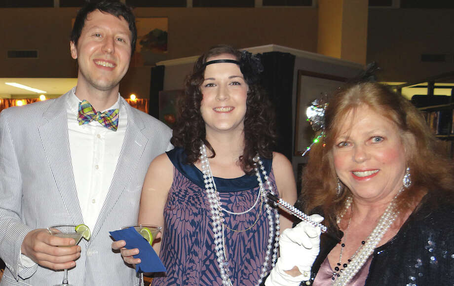 Paul and Mariel Ulane of New York City, with Pamela Norman of Southport at the Great Gatsby Party at Westport Public Library on Saturday night.  WESTPORT NEWS, CT 3/2/13 Photo: Mike Lauterborn / Westport News contributed