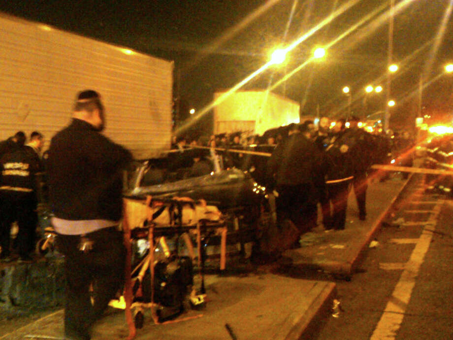 In this photo provided by VosIzNeias.com, first responders work at the scene shortly after a car accident in Brooklyn's Williamsburg neighborhood took the lives of an expectant couple Sunday, March 3, 2013, in New York. The young couple who had taken a car service to a hospital for the birth of their first child were killed en route in a hit and run early, but their baby boy survived, authorities said. (AP Photo/VosIzNeias.com, Eli Wohl) MANDATORY CREDIT Photo: Eli Wohl