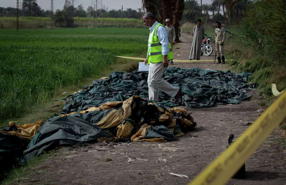 An Egyptian inspector of the Civil Aviation Authority investigates the site of the balloon accident, in Luxor, Egypt, Tuesday. Photo: AP