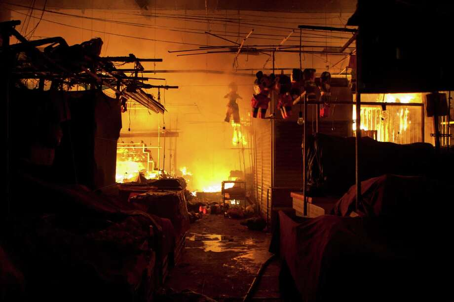 A fire consumes stalls inside the Merced market in the early morning hours of Wednesday. A fire ripped through Mexico City's biggest traditional marketplace on Wednesday, causing extensive damage but no initial reports of fatalities. Photo: AP