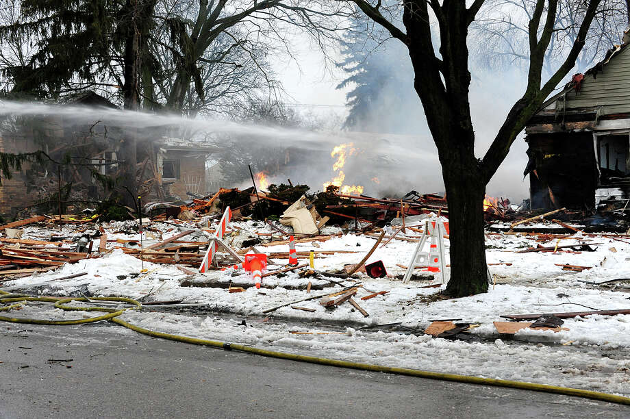 Firefighters work the scene of an explosion that destroyed a home and killed a man Wednesday in Royal Oak, Mich. (AP Photo/Detroit News, Ricardo Thomas)  Photo: AP