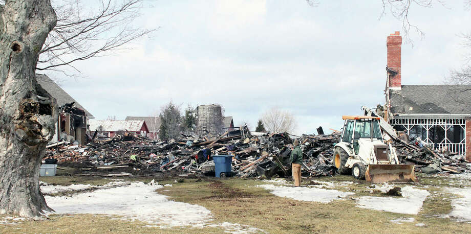 A porch and garage are all that is left of the Replogle Farm a historic home in the 4500 block of Johnson Road after a fire destroyed it Saturday in LaPorte, Ind. Photo: AP