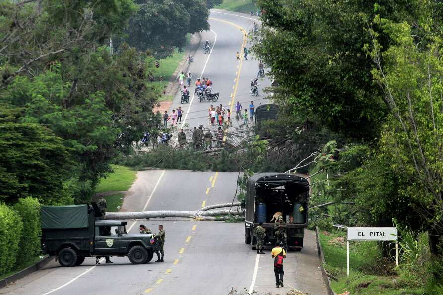 Soldiers guard a roadblock set by small farmers on the Pan American Highway in Piendamo, southern Co