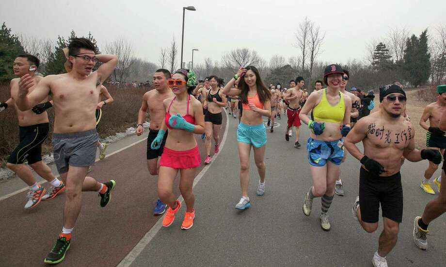 "Half-naked participants take part in the ""Guangzhu (naked) Run"" last weekend at the Olympic Forest Park in chilly Beijing. The event, which required participants to run wearing only their underwear for 2.2 miles, as a way to promote environmentally-friendly lifestyles.  Photo: AP"