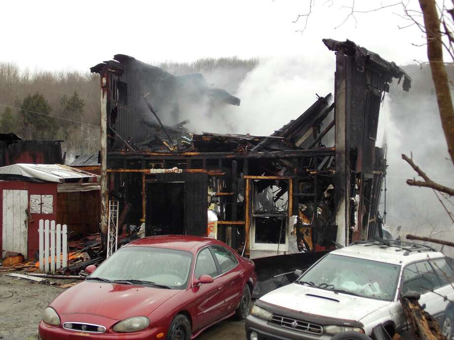 A Wells Township residence belonging to Don Seeley and Judy Lee and their two children, destroyed  in a fire is shown Tuesday morning, Feb. 26, 2013, on Coryland Road in Wells Township, Pa. No one was injured in the fire. Photo: AP