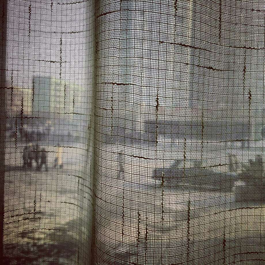 In this photo taken in January with an iPod Touch and posted to instagram, North Koreans walk along a Pyongyang street and seen through a coffee shop window curtain. This year, foreigners are allowed for the first time to bring mobile phones into North Korea. And this week the local service provider, Koryolink, is allowing foreigners to access the Internet on a data capable 3G connection on mobile phones. Photo: AP