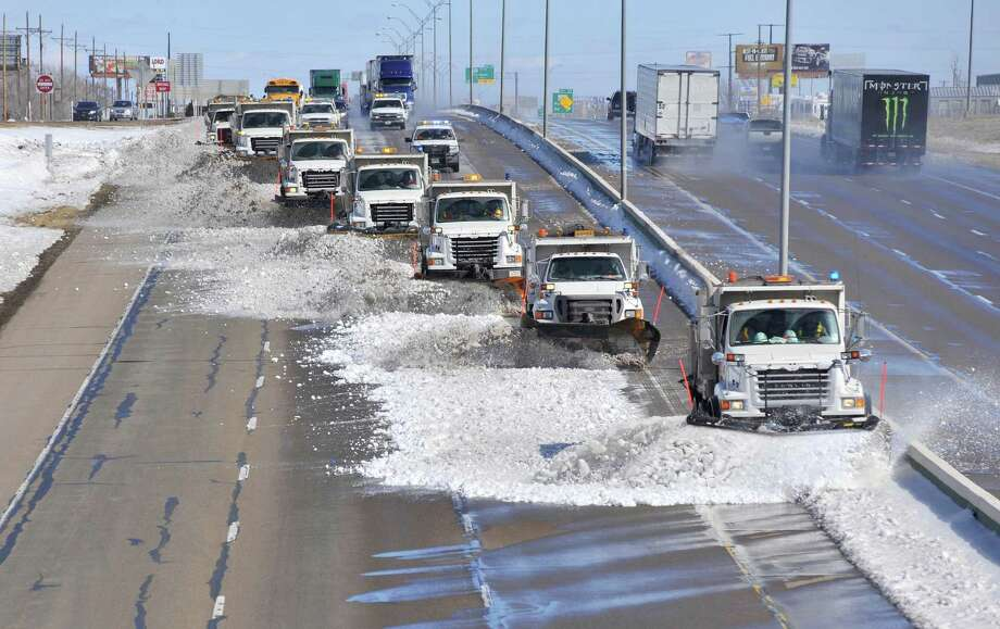 Texas Department of Transportation snow removal crews performed a tear procedure using more than 10 snow plow trucks in tandem to push snow drifts from the center median of Interstate 40 to the shoulder Wednesday, after a record breaking blizzard covered the Texas Panahandle with 19-inches of Snow Monday. Traffic was slowed to 35 mph behind the convoy of trucks. The procedure keeps snow melting on the highway from re-freezing overnight and causing hazardous conditions for drivers. Photo: AP