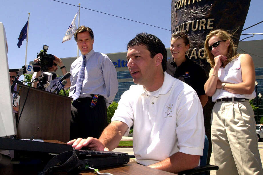 Olympic medalist Andy Gabel demonstrates how to purchase 2002 Winter Game tickets via the Internet during a news conference in Salt Lake City in 2000. Looking on is Salt Lake Organizing Committee president Mitt Romney, left,  and Olympic medalists Hilary Lindh and Denise Parker, right.  U.S. Speedskating began an investigation Friday into the report of a female skater accusing former Olympian and organization president Andy Gabel of sexual abuse in the 1990s. Photo: AP