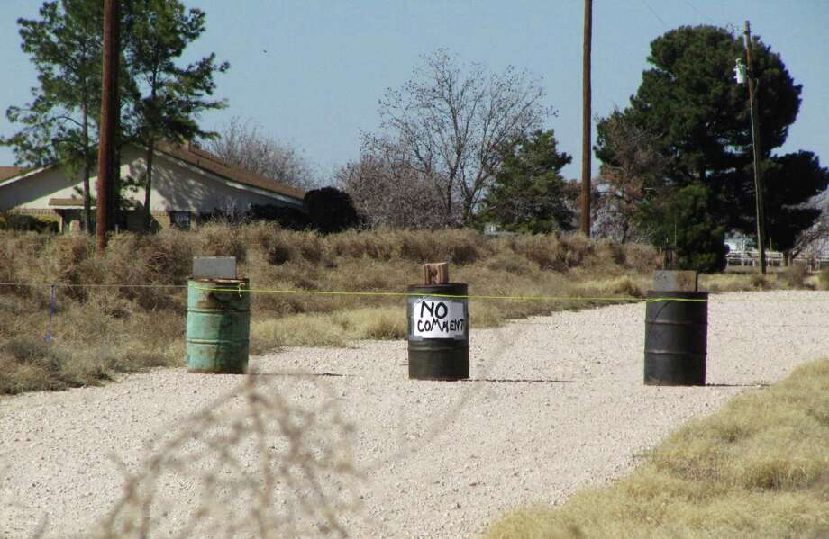The driveway to the Shatto family home, rear left, is seen in Gardendale, Texas, Friday. The death of  3-year-old Max Shatto, an adopted Russian boy has been ruled an accident by West Texas authorities, who said Friday that they continue to investigate the possibility of criminal charges in a case that has become the latest flashpoint in the debate over international adoption. Photo: AP