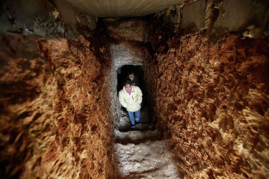 Syrian children, walk out of an underground tunnel that their father made with a jackhammer for shelter from Syrian government forces shelling and airstrikes, at Jirjanaz village, in Idlib province, Syria, Thursday. Across northern Syria, rebels, soldiers, and civilians are making use of the country's wealth of ancient and medieval antiquities to protect themselves from Syria's two-year-old war. They are built of thick stone that has already withstood centuries, and are often located in strategic locations overlooking towns and roads. Photo: AP