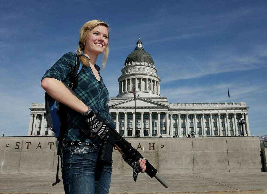 Darci Lund carries an AR-15 at a gun rights rally and march at the Utah State Capitol on Saturday in Salt Lake City, Utah. The rally attracted several hundred people for the march to the Utah Capitol in favor of 2nd Amendment rights as gun control supporters call for more limits and bans on assault weapons. Photo: George Frey, Getty / 2013 Getty Images