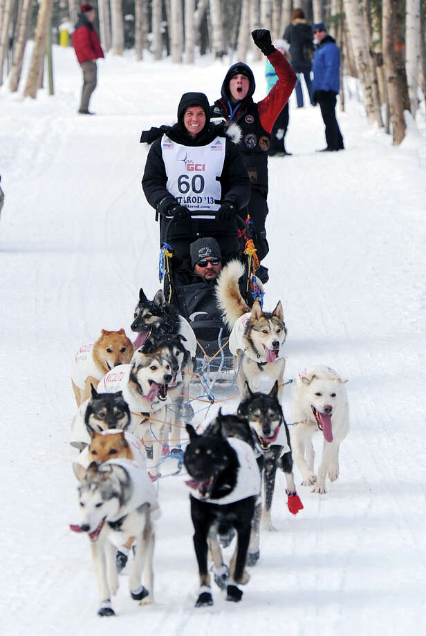 Cindy Abbott of Irvine, Calif., drives her team along the Chester Creek Greenbelt during the ceremonial start of the Iditarod Trail Sled Dog Race on Saturday, March 2, 2013, in Anchorage, Alaska. The competitive portion of the 1,000-mile race is scheduled to begin Sunday in Willow, Alaska. Photo: AP