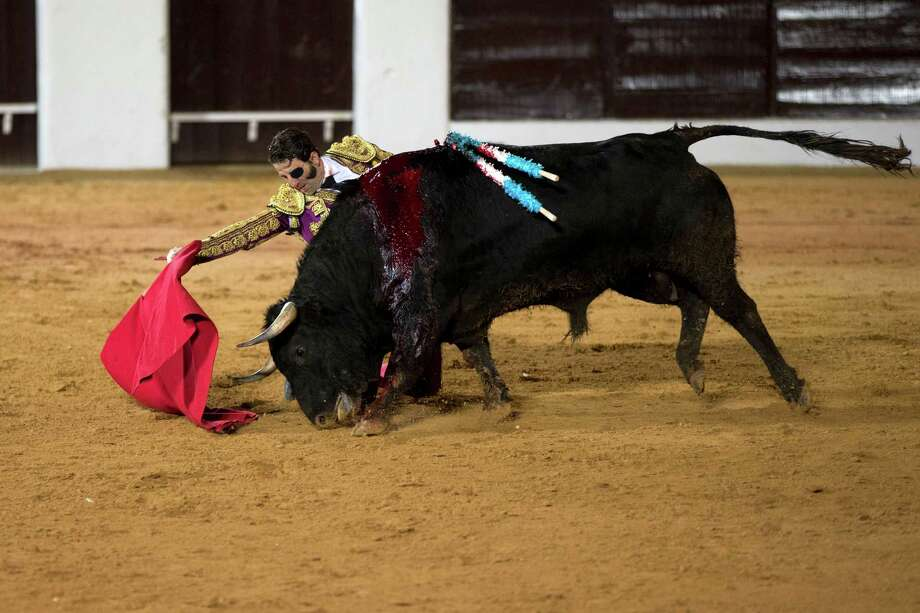Spanish bullfighter Juan Jose Padilla performs with a bull during the first bullfight of the season in the southwestern Spanish town of Olivenza, Spain, on Saturday. Bullfighting is an ancient tradition in Spain and the season runs from March to October. Photo: AP