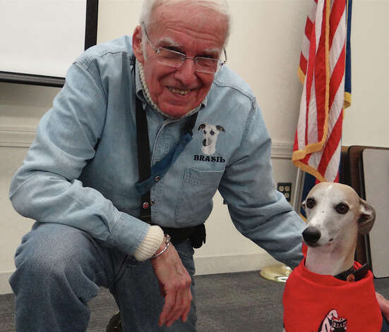Don Smith, a therapy dog handler, with Brasil at Fairfield Public Library on Saturday afternoon.  FAIRFIELD CITIZEN, CT 3/2/13 Photo: Mike Lauterborn / Fairfield Citizen contributed