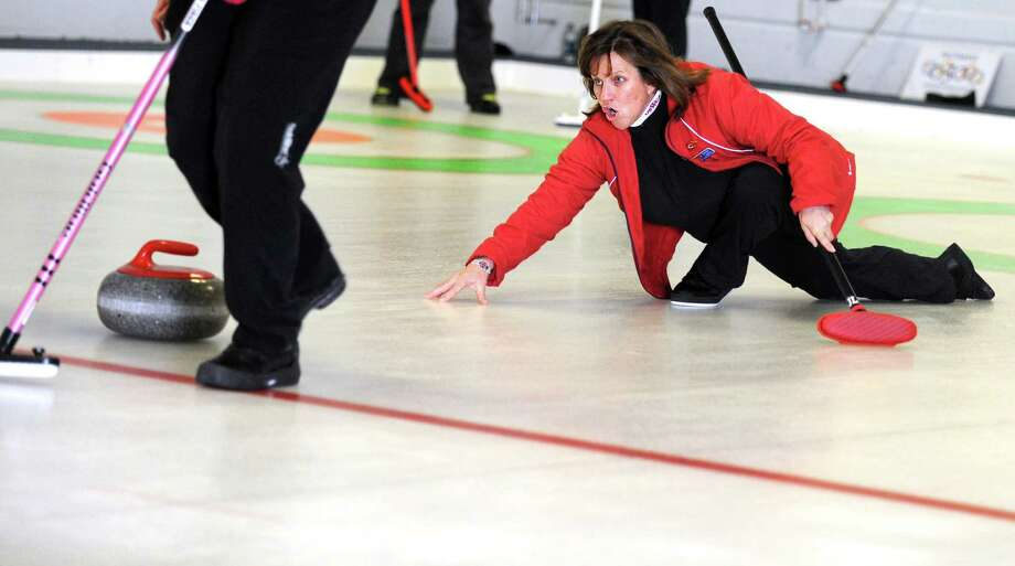 Naida Leslie, of New Canaan, delivers a curling stone during a tournament game Tuesday, Feb. 26, 2013 at the Nutmeg Curling Club in Bridgeport, Conn. Photo: Autumn Driscoll / Connecticut Post