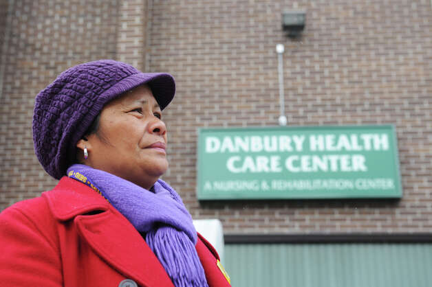 Danbury Health Care Center C.N.A. Elena DeBiase, of Danbury, Conn., waits outside the Danbury Health Care Center in Danbury, Conn. before her shift to welcome employees back to work Sunday, March 3, 2013 after being on strike since July.  DeBiase is a strike captain in the New England Health Care Employees Union District 1199. Photo: Tyler Sizemore / The News-Times