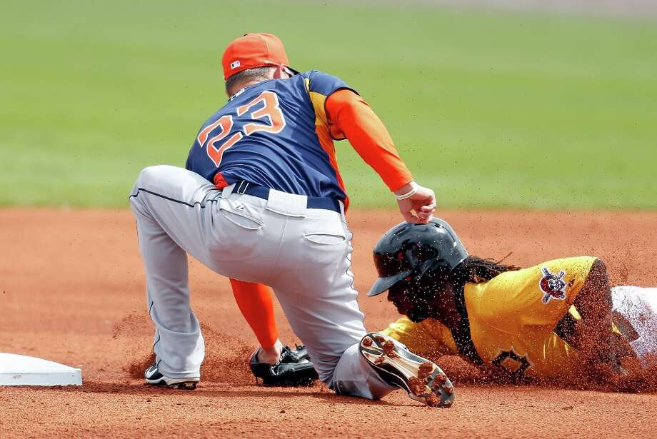 Pirates 8, Astros 6Astros shortstop Tyler Greene applies the tag to Pittsburgh Pirates outfielder Andrew McCutchen on a first-inning steal attempt on Sunday at McKechnie Field in Bradenton, Fla. Photo: J. Meric / 2013 Getty Images