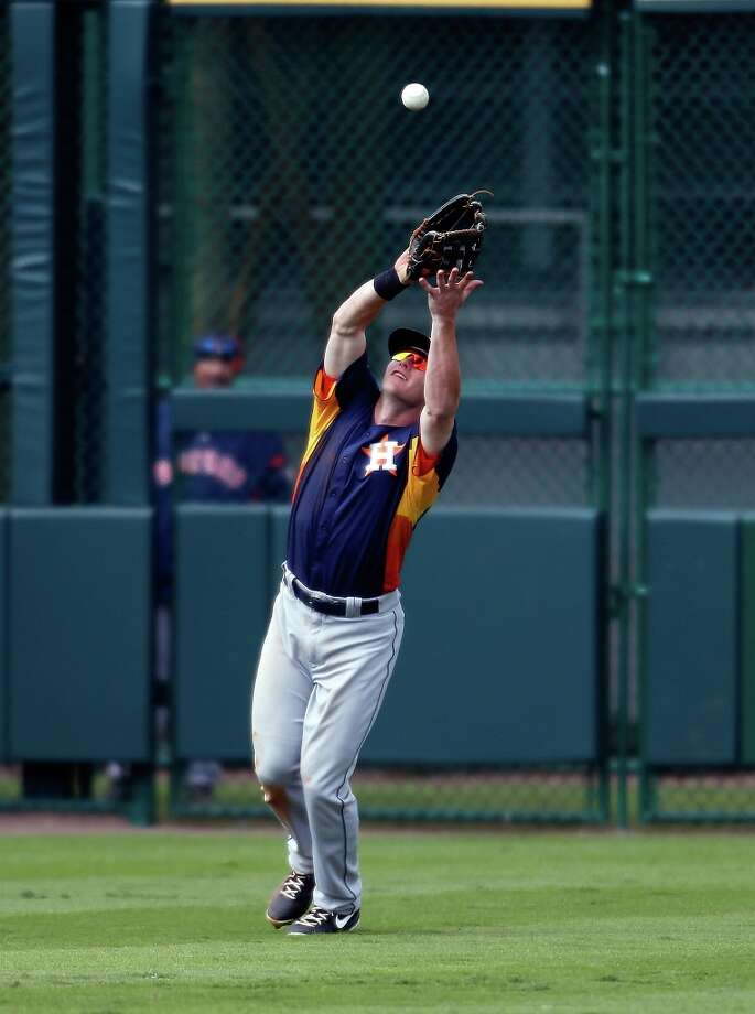 Outfielder Robbie Grossman catches a fly ball. Photo: J. Meric / 2013 Getty Images