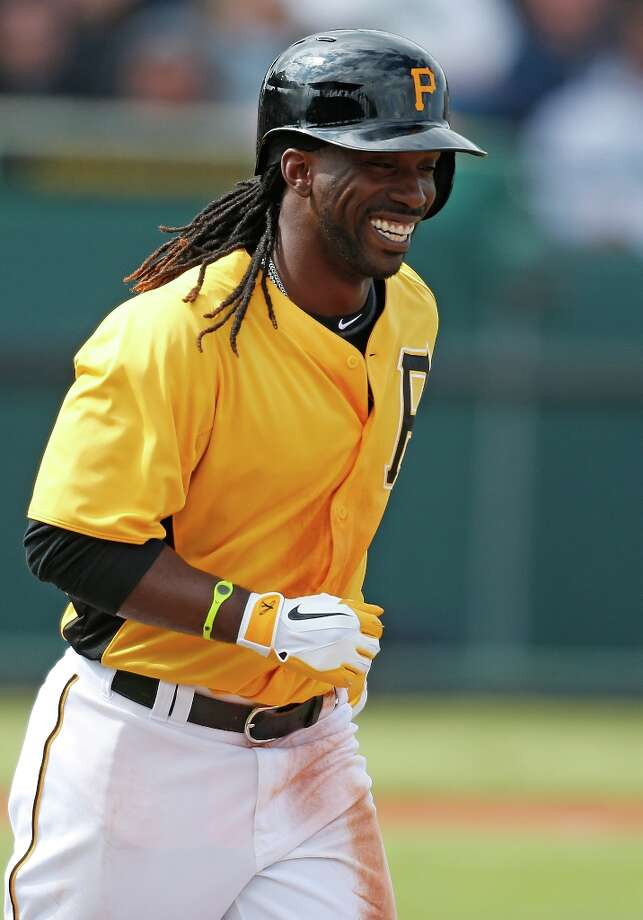 Andrew McCutchen smiles as he jogs to first base. Photo: J. Meric / 2013 Getty Images