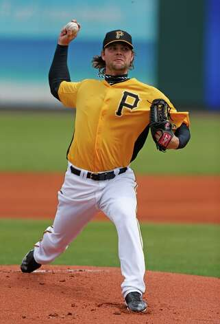 Pitcher Kyle McPherson works during Sunday's game. Photo: J. Meric / 2013 Getty Images