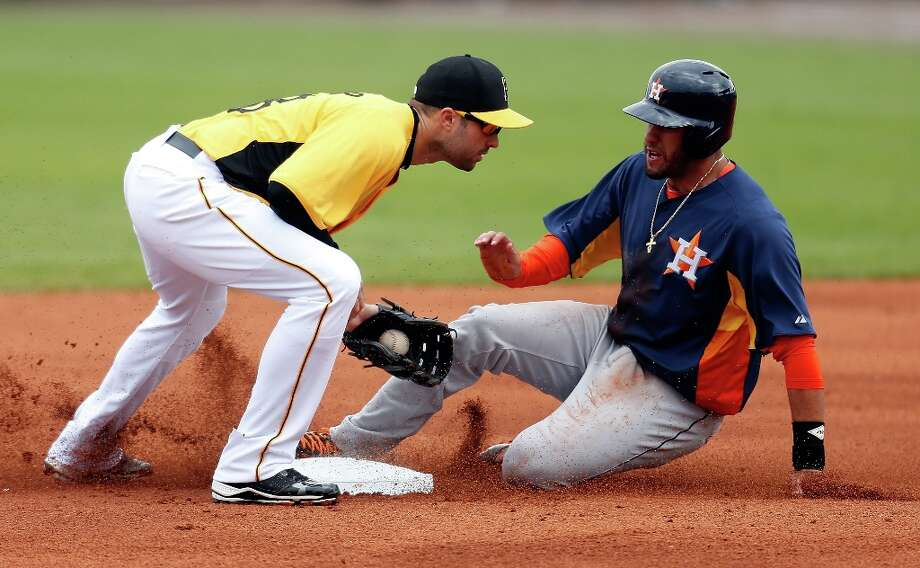 Infielder Neil Walker tags out J.D. Martinez on a steal attempt. Photo: J. Meric / 2013 Getty Images