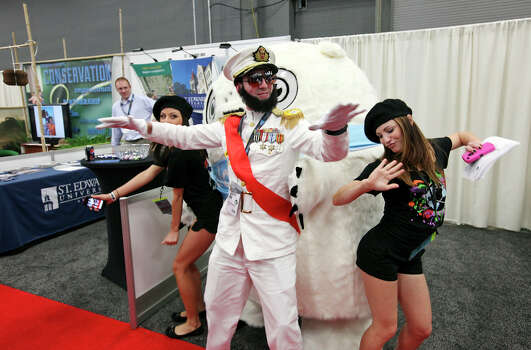 "FOR METRO - David Stepanyan, as ""The Dictator"" (center) and Gabriela Bogner (left) and Lori Brown as his entourage dance with the ""Glomper"" while advertising Equilibrium's EQ Network during the South by Southwest trade show Monday March 12, 2012 at the Austin Convention Center in Austin, TX. Photo: EDWARD A. ORNELAS, SAN ANTONIO EXPRESS-NEWS / © SAN ANTONIO EXPRESS-NEWS (NFS)"