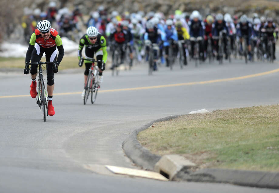 Laurence Merling, left, of Guilford, Conn., leads Dave Warner, of Jamaica Plain, Mass. and other participants in the Ronde de Bethel category 3-4 race at a loop near the Outdoor Sports Center in Bethel, Conn. Sunday, March 3, 2013.  The day began at 8 a.m. and riders from six divisions competed in different races, ranging from 15 laps to 46 laps on the .9 mile loop.  This race event was the first of seven events in the Bethel Spring Series. Photo: Tyler Sizemore / The News-Times