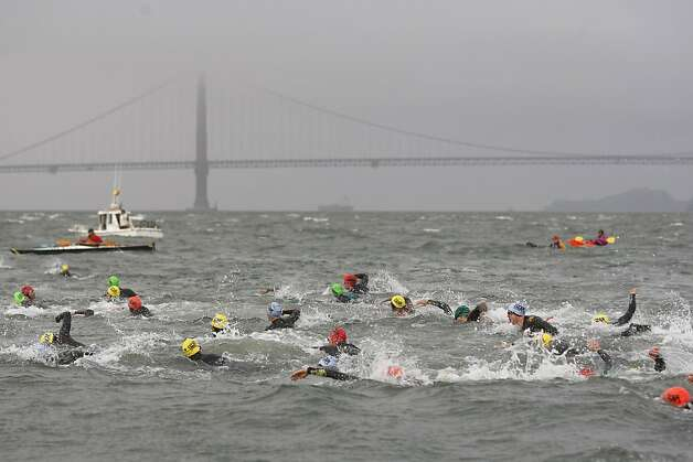 Triathletes swim across the bay in the Escape From Alcatraz Triathlon, held three months early this year. Photo: James Tensuan, The Chronicle