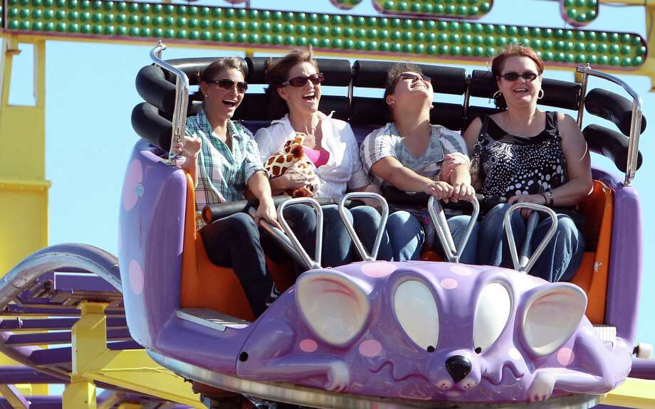 Danielle Williams, Linda Cullums, Morgan Armour, and Maxine Armour ride the Crazy Coaster at Houston Livestock Show & Rodeo at Reliant Stadium on Sunday, March 3, 2013, in Houston. Photo: Mayra Beltran, Houston Chronicle / © 2013 Houston Chronicle