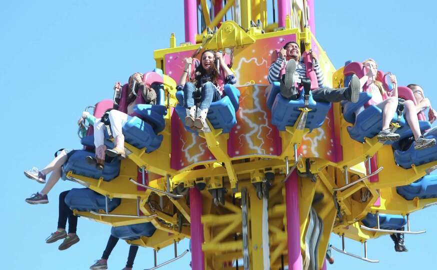 Adventure seeks ride the carnival rides at Houston Livestock Show & Rodeo at Reliant Stadium on