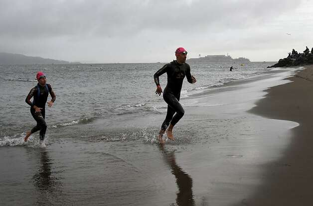 Triathletes emerged from the bay after a grueling swim. The annual Escape from Alcatraz triathlon was held early Sunday morning March 3, 2013 beginning with a swim in the bay and ending with an eight mile run to the finish line at the Marina Green. Photo: Brant Ward, The Chronicle