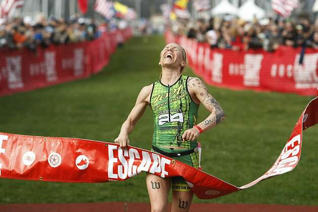 Heather Jackson reacts as she finishes first for the women in the Escape from Alcatraz Triathlon on March 3.The triathlon featured swimming from Alcatraz to the Marina followed by an 18 mile bike ride and an 8 mile run. Photo: James Tensuan, The Chronicle