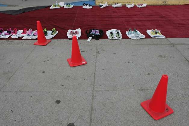 Shoes are set aside for the professional triathletes to transition from swimming to running during the Escape from Alcatraz Triathlon on Sunday, March 3.  The triathlon featured swimming from Alcatraz to the Marina followed by an 18 mile bike ride and an 8 mile run. Photo: James Tensuan, The Chronicle