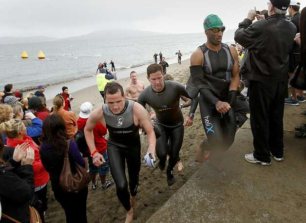 Triathletes ran up the stairs near the St. Francis Yacht Club after finishing the swim in the bay. The annual Escape from Alcatraz triathlon was held early Sunday morning March 3, 2013 beginning with a swim in the bay and ending with an eight mile run to the finish line at the Marina Green. Photo: Brant Ward, The Chronicle