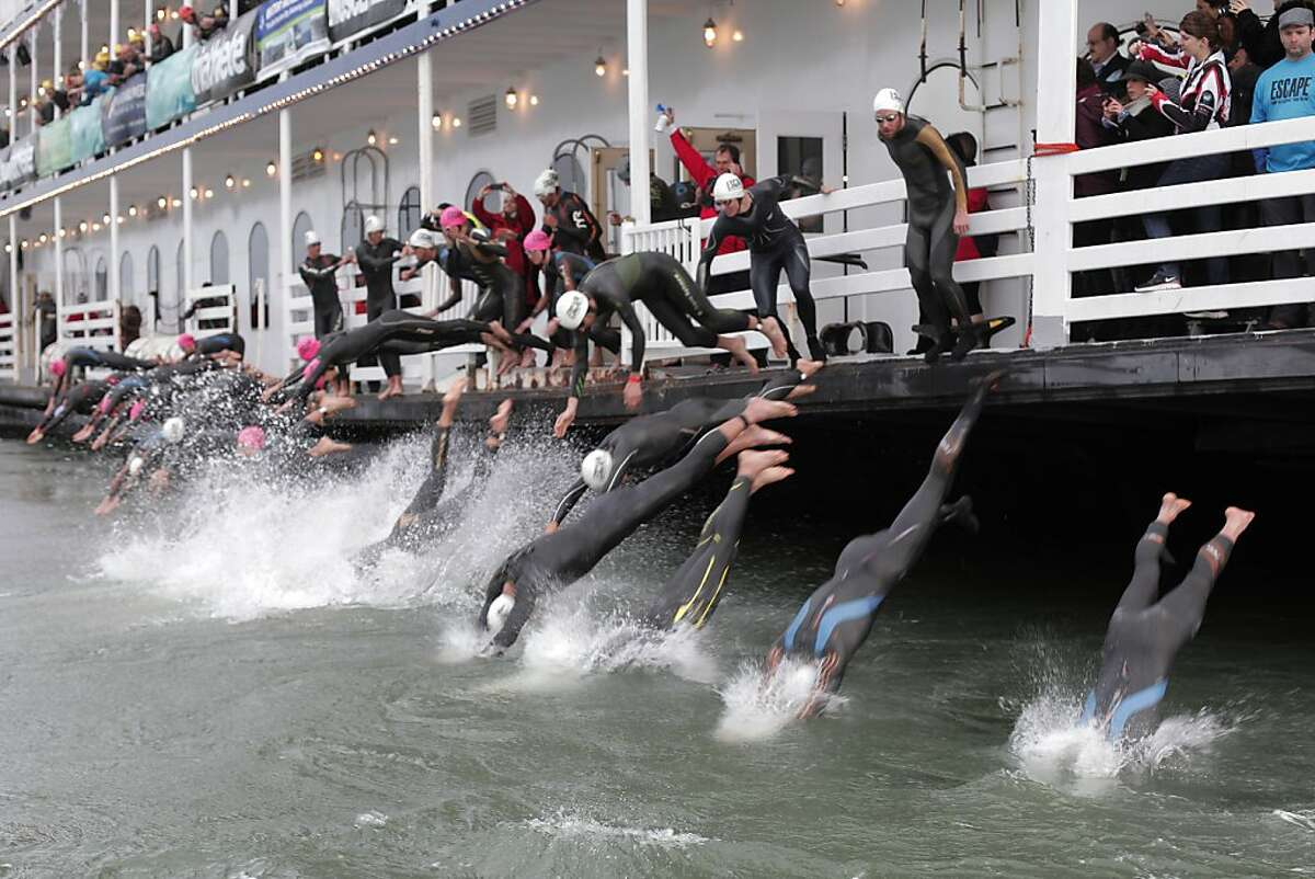 Triathletes take to the bay as they begin the Escape from Alcatraz Triathlon on Sunday, March 3. The triathlon featured swimming from Alcatraz to the Marina followed by an 18 mile bike ride and an 8 mile run.