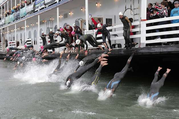 Triathletes take to the bay as they begin the Escape from Alcatraz Triathlon on Sunday, March 3. The triathlon featured swimming from Alcatraz to the Marina followed by an 18 mile bike ride and an 8 mile run. Photo: James Tensuan, The Chronicle