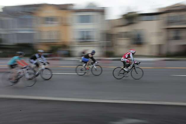 Cyclists make their way through the Marina as they compete in the Escape from Alcatraz Triathlon on Sunday, March 3. The triathlon featured swimming from Alcatraz to the Marina followed by an 18 mile bike ride and an 8 mile run. Photo: James Tensuan, The Chronicle