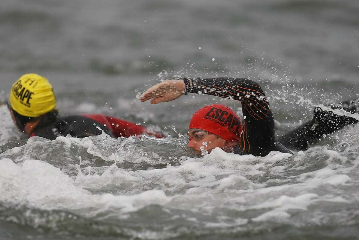 Triathletes swim from across the bay during the Escape from Alcatraz Triathlon on Sunday, March 3. The triathlon featured swimming from Alcatraz to the Marina followed by an 18 mile bike ride and an 8 mile run.