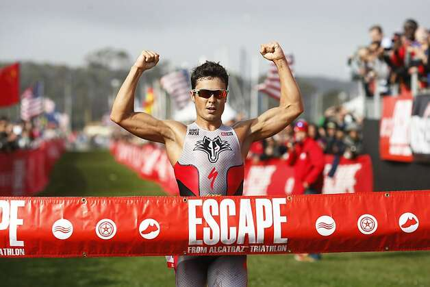 Javier Gomez finishes first for the men's in the Escape from Alcatraz Triathlon on Sunday, March 3. The triathlon featured swimming from Alcatraz to the Marina followed by an 18 mile bike ride and an 8 mile run. Photo: James Tensuan, The Chronicle