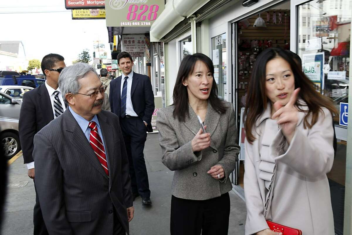 San Francisco Mayor Ed Lee, left, and new supervisor Katy Tang, right, speak with Caroline Yee, center as they took a walk along Irving Street to meet merchants on Thursday, February 28, 2013, in San Francisco, Calif,.