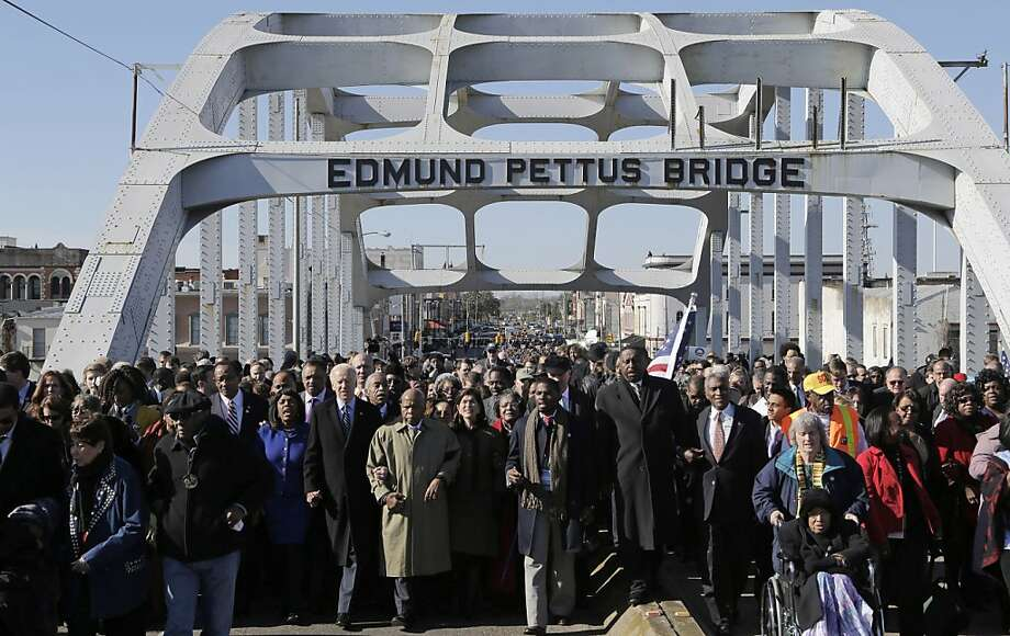 Vice President Joe Biden and U.S. Rep. John Lewis, D-Ga.,  lead a group across the Edmund Pettus Bridge in Selma, Ala., Sunday, March 3, 2013. They were commemorating the 48th anniversary of Bloody Sunday, when police officers beat marchers when they crossed the bridge on a march from Selma to Montgomery. Photo: Dave Martin, Associated Press
