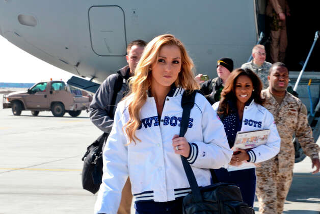 Dallas Cowboys Cheerleaders Cassie Trammell (front) and Jackie Bob, along with Peyton Manning, Curt Schilling, Austin Collie and Vincent Jackson arrive at Bagram Air Field, Afghanistan, to entertain the troops with a USO tour March 1, 2013. Photo: Staff Sgt. Dave Overson, U.S. Army / Public Domain